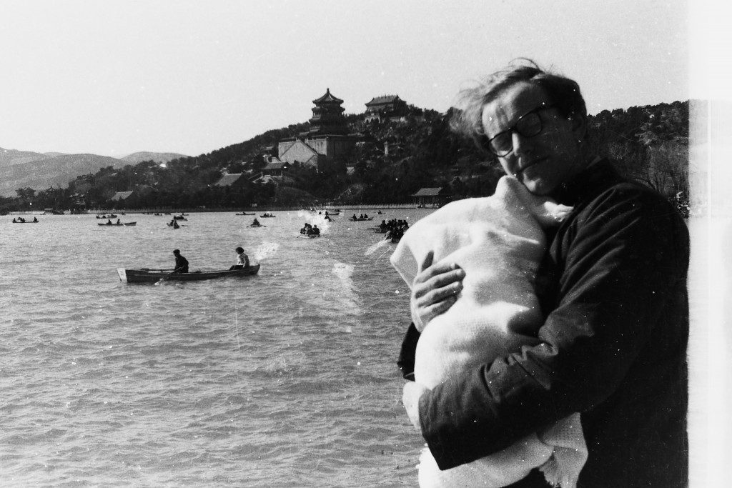 Colin with newborn in Beijing 1965.