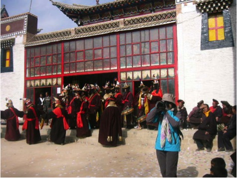 The Dancers come out of the temple