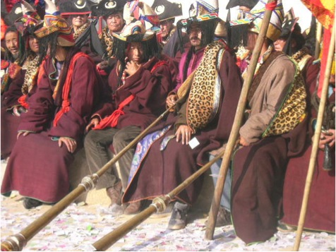 The accompanying instruments include the Tibetan long horn