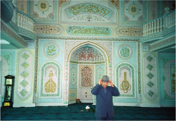 The inside of a Chinese-style mosque in Ürümqi together with a Hui cleric.