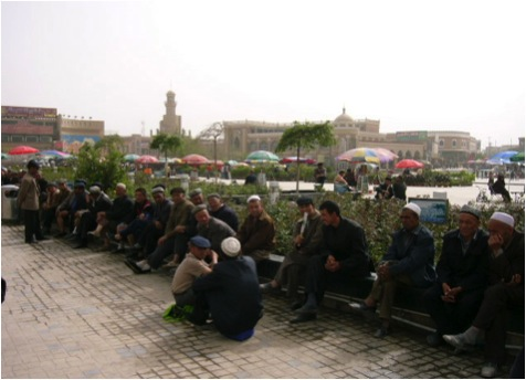 Old Uygurs chat in the big square outside the Idkah Mosque, May 2007