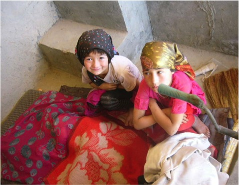 One of the workers at the Hotan silk factory has to keep her small daughters with her, due to lack of childcare services, October 2010