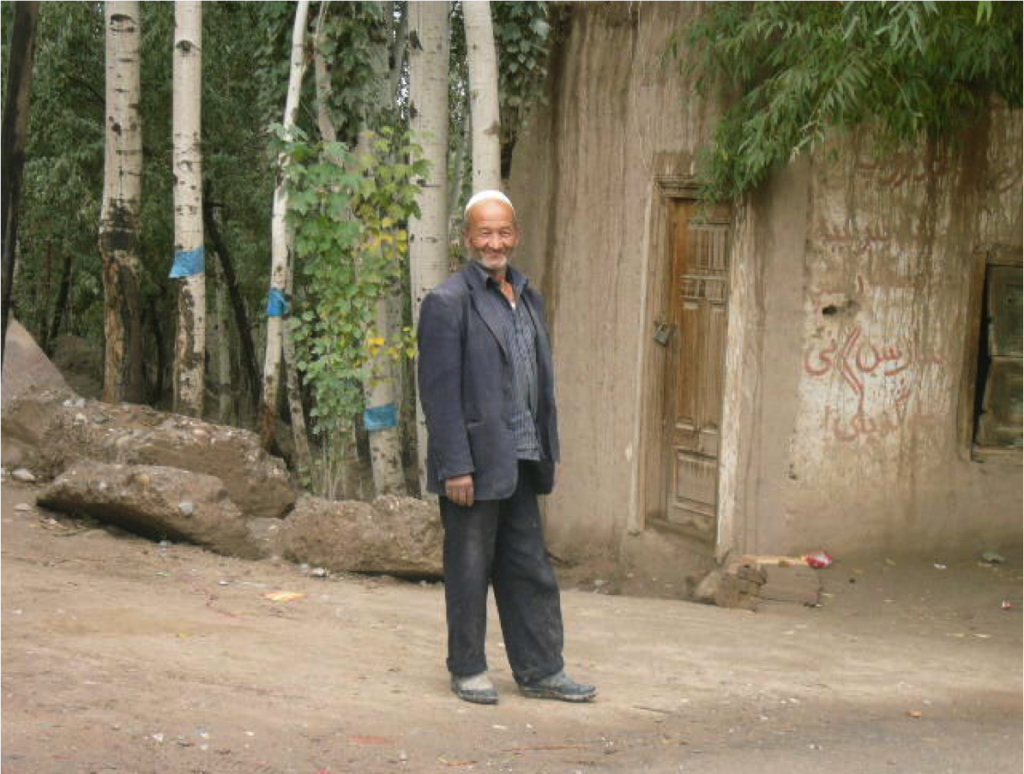 An old Uygur man outside his house in a rural street near Kashgar, southwest Xinjiang. Taken in October 2010