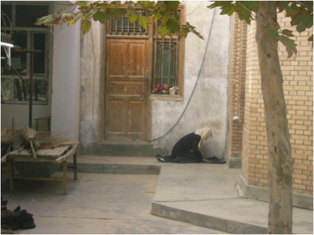 A women prayers in the Hotan Mosque, away from the main prayer hall